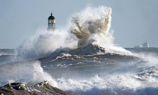 Waves crash against the pier wall at Seaham Lighthouse on the County Durham coast