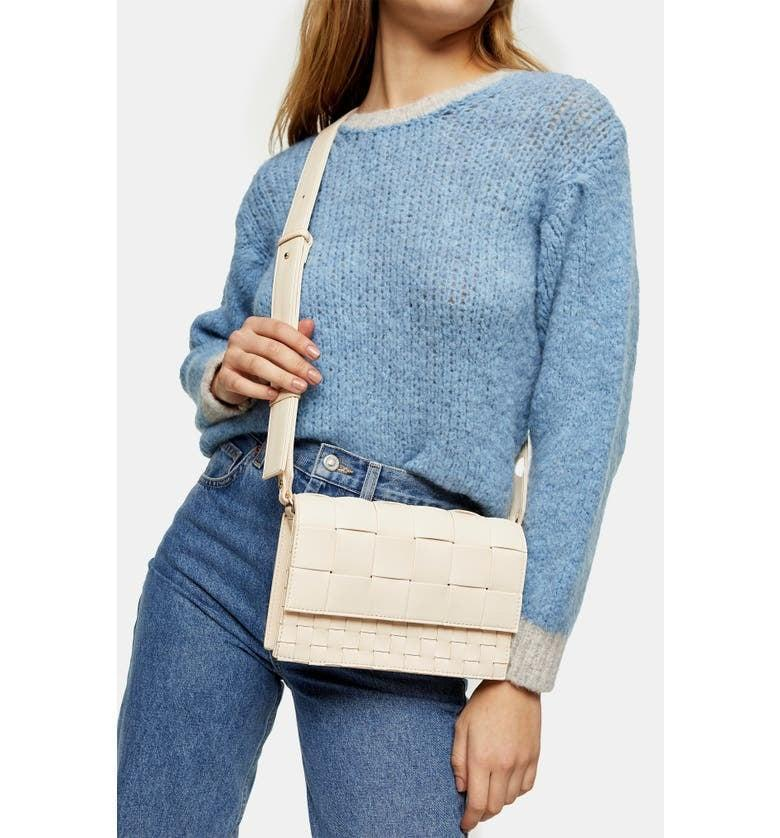 <p>This <span>Topshop Mixed Weave Crossbody Bag</span> ($50) goes with everything.</p>