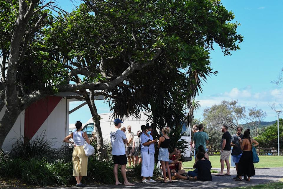 People lining up to be tested at a walk-through Covid testing site at the Surf Life Saving Club in Byron Bay, Australia.