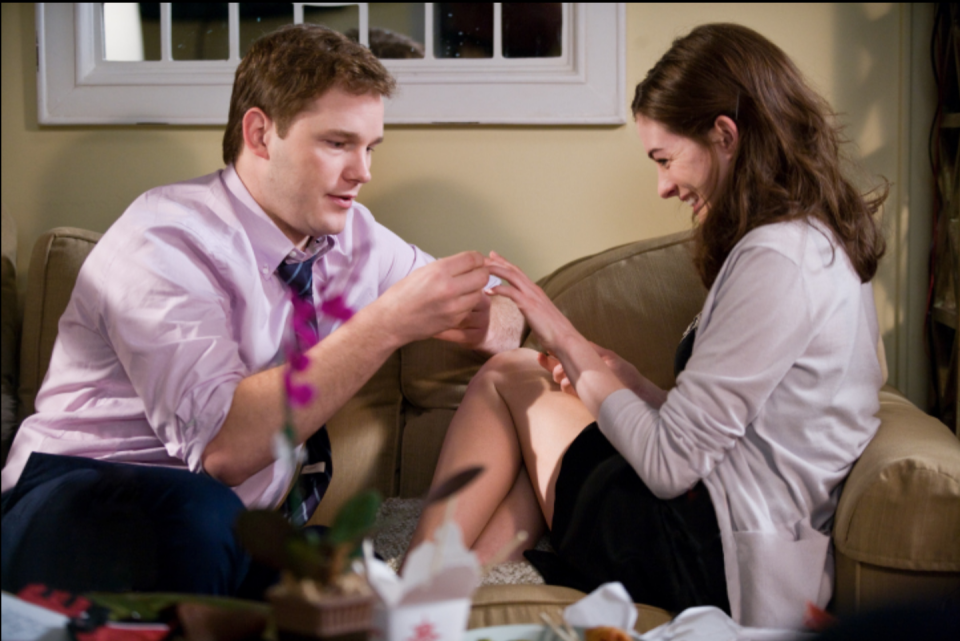 <p>Anne Hathaway's character, Emma, was the token easy going, low-maintenance girlfriend. Which is why her boyfriend proposed at home by hiding the ring in the takeout fortune cookie. </p>
