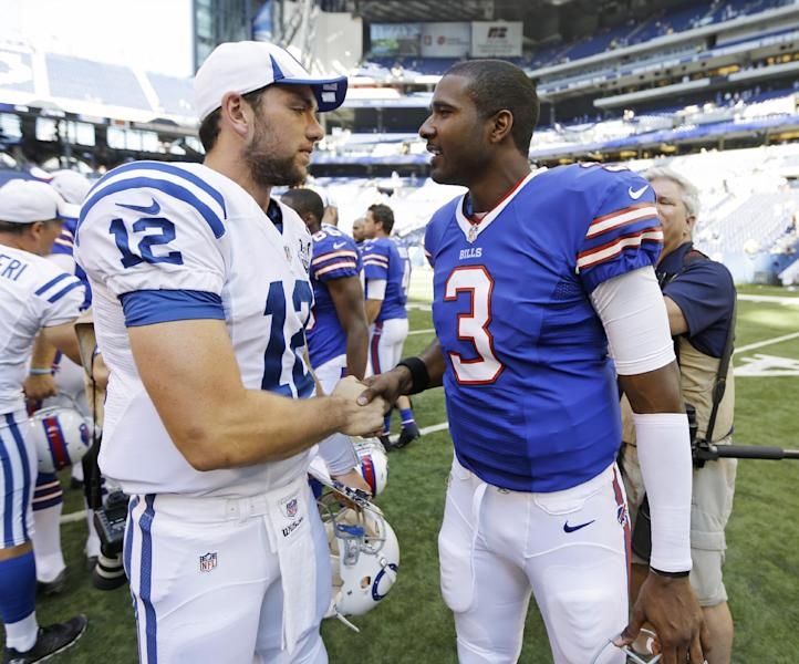 Indianapolis Colts' Andrew Luck (12) talks with Buffalo Bills' EJ Manuel following an NFL preseason football game on Sunday, Aug. 11, 2013, in Indianapolis. Buffalo defeated Indianapolis 44-20. (AP Photo/Michael Conroy)