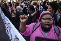 """""""What they did to George Floyd was terrible, """" said Shawna Harris, one of the protesters who marched in downtown Minneapolis, Monday, March 8, 2021, on the first day of the Derek Chauvin trial which began with jury selection. (Richard Tsong-Taatarii/Star Tribune via AP)"""