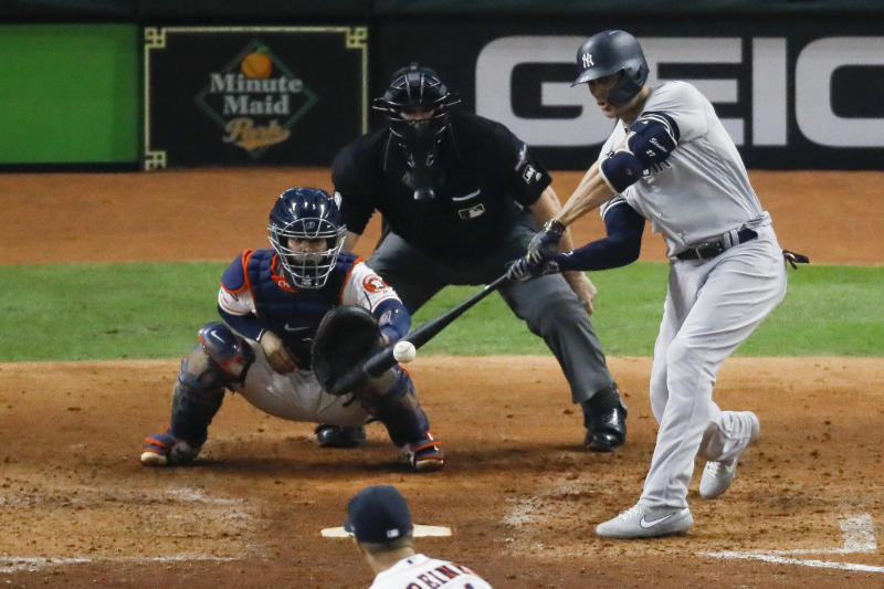 New York Yankees' Giancarlo Stanton hits a home run against the Houston Astros during the sixth inning in Game 1 of baseball's American League Championship Series Saturday, Oct. 12, 2019, in Houston. (AP Photo/Sue Ogrocki)