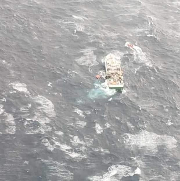 The Atlantic Destiny was still in rough waters when rescue crews removed the final crew members from the vessel.