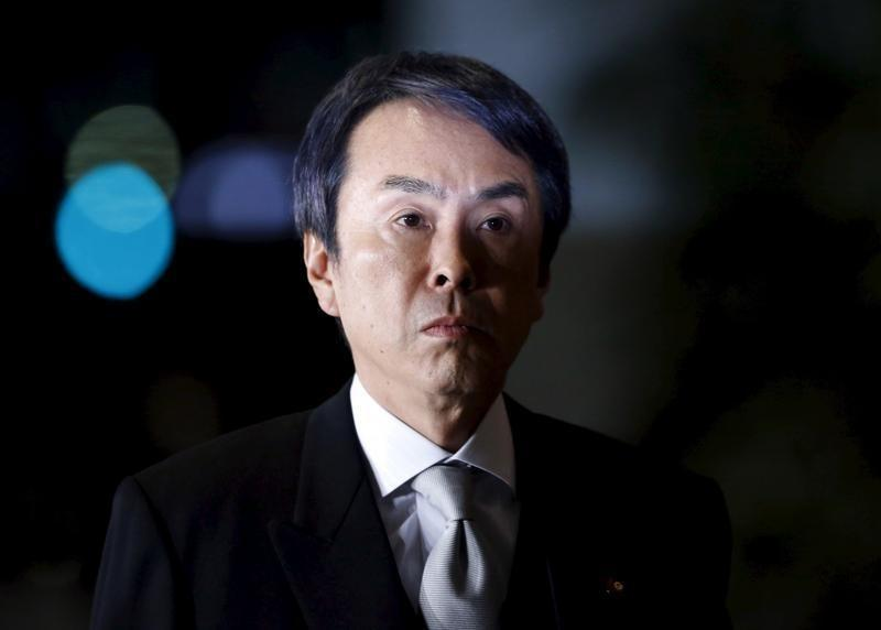 Japan's newly appointed Economics Minister Ishihara walks into Japan's Prime Minister Abe's official residence in Tokyo