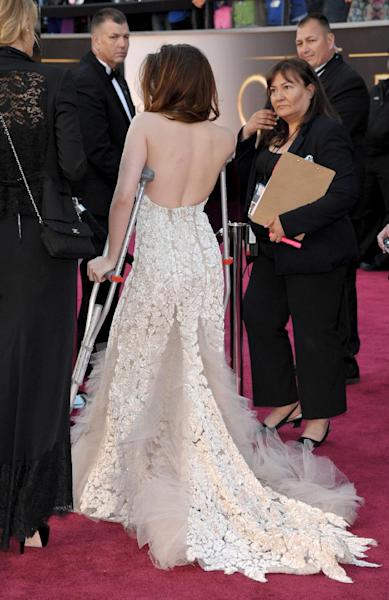 Actress Kristen Stewart arrives with crutches at the Oscars at the Dolby Theatre on Sunday Feb. 24, 2013, in Los Angeles. (Photo by John Shearer/Invision/AP)