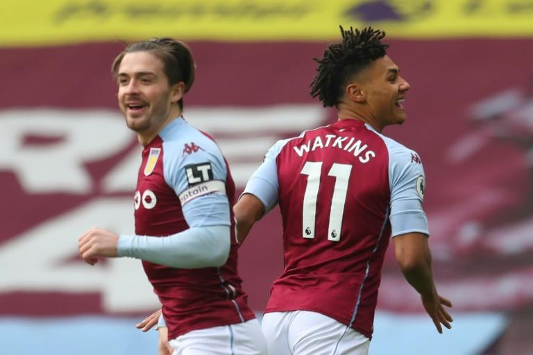 Aston Villa striker Ollie Watkins (R) celebrates with Jack Grealish