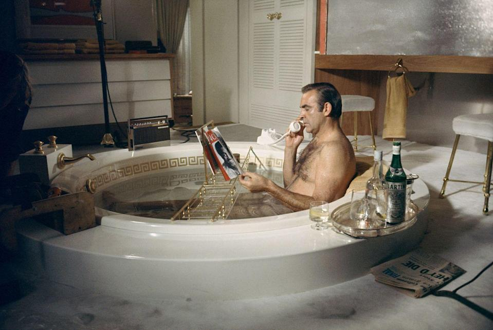 <p>Sean Connery takes a relaxing bath with a vodka martini on the set of Diamonds Are Forever.</p>
