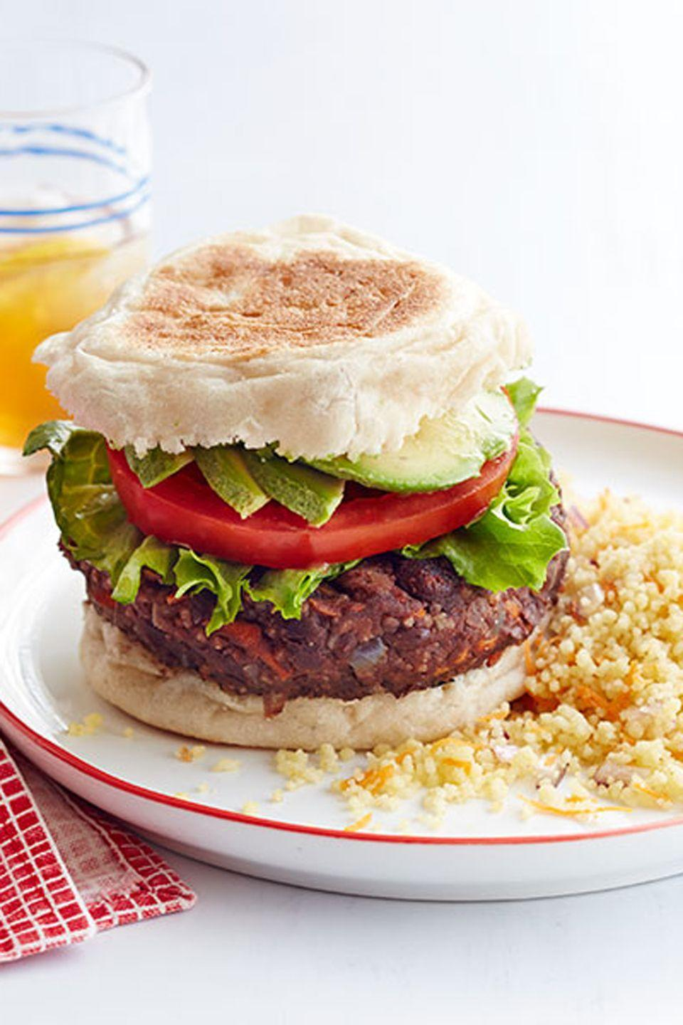 "This hearty bean patty serves as the perfect base for your favorite burger toppings. <a href=""https://www.countryliving.com/food-drinks/recipes/a34824/black-bean-veggie-burger-couscous-recipe-wdy0714/"" rel=""nofollow noopener"" target=""_blank"" data-ylk=""slk:Get the recipe"" class=""link rapid-noclick-resp""><strong>Get the recipe</strong></a><strong>.</strong> <a href=""https://www.amazon.com/T-fal-Specialty-Nonstick-Dishwasher-Cookware/dp/B000EM9PTQ?tag=syn-yahoo-20&ascsubtag=%5Bartid%7C10050.g.32934702%5Bsrc%7Cyahoo-us"" class=""link rapid-noclick-resp"" rel=""nofollow noopener"" target=""_blank"" data-ylk=""slk:SHOP SAUTE PANS""><strong>SHOP SAUTE PANS</strong></a><br>"