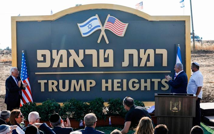 View of the sign of a Golan settlement named after Donald Trump - AFP/AFP