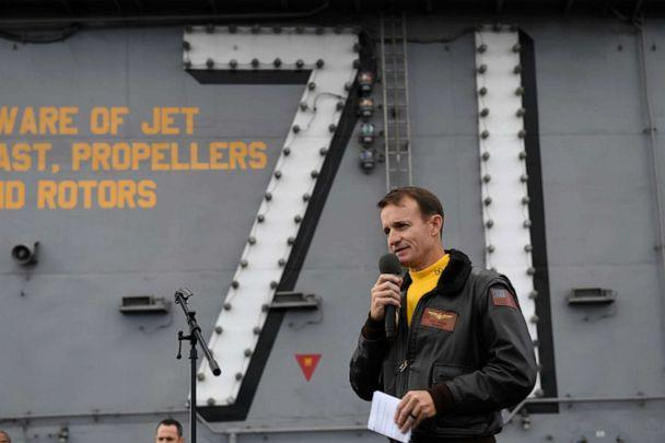PHOTO: Capt. Brett Crozier, commanding officer of the aircraft carrier USS Theodore Roosevelt (CVN 71), addresses the crew during an all-hands call. (Mc3 Nicholas Huynh/U.S. Navy)