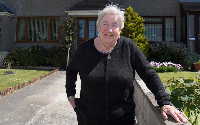 Barbara Binns outside her home, a mile from her grandson's recently acquired manor house - Dale Cherry