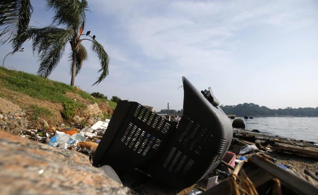A television part is seen on Fundao beach in the Guanabara Bay in Rio de Janeiro March 13, 2014. According to the local media, the city of Rio de Janeiro continues to face criticism locally and abroad that the bodies of water it plans to use for competition in the 2016 Olympic Games are too polluted to host events. Untreated sewage and trash frequently find their way into the Atlantic waters of Copacabana Beach and Guanabara Bay - both future sites to events such as marathon swimming, sailing and triathlon events. REUTERS/Sergio Moraes (BRAZIL - Tags: ENVIRONMENT SPORT OLYMPICS)