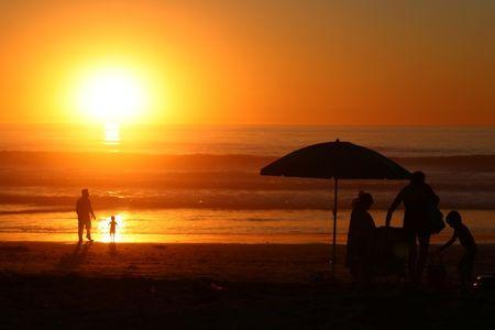 Families cool off at sunset in Solana Beach in Southern California