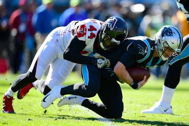 Kyle Allen of the Carolina Panthers is sacked by Vic Beasley of the Atlanta Falcons on Sunday. (Photo by Jacob Kupferman/Getty Images)