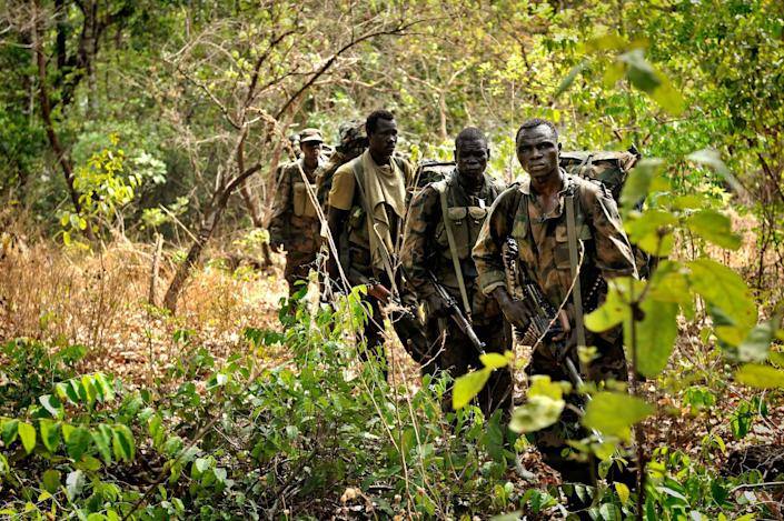 Ugandan soldiers patrol on April 18, 2012 through the Central African jungle during an operation to fish out notorious Lord's Resistance Army (LRA) leader Joseph Kony (AFP Photo/Yannick Tylle)