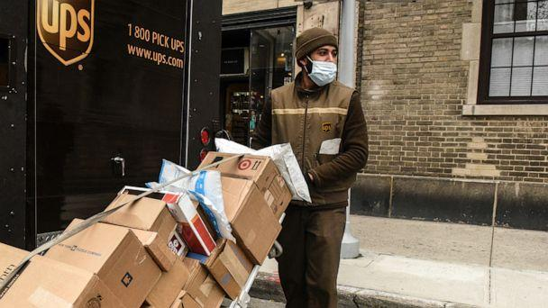 PHOTO: In this April 29, 2020, file photo, a UPS worker delivers packages in New York. (Stephanie Keith/Getty Images, FILE)