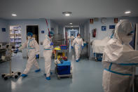Staffers of the Severo Ochoa Hospital work at the COVID-19 ward in Leganes on the outskirts of Madrid, Spain, Wednesday, Feb. 17, 2021. One year ago, staff had to deal with the exasperation of fighting an unknown enemy, the fear of bringing the virus back home, the scarcity of protective gear and the bodies lined up in the morgue. (AP Photo/Bernat Armangue)
