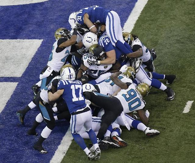 Indianapolis Colts' Donald Brown (31) dives over the top for a one-yard touchdown run during the first half of an NFL football game against the Jacksonville Jaguars Sunday, Dec. 29, 2013, in Indianapolis. (AP Photo/AJ Mast)