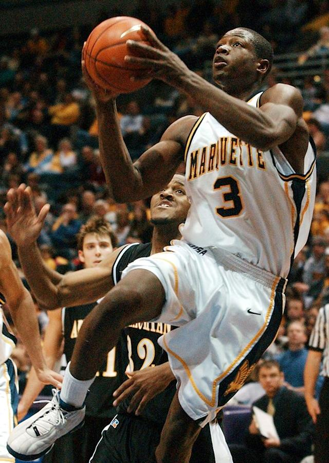 Marquette's Dwyane Wade (3) puts up a shot in front of Appalachian State's Chris McFarland (32) in the first half Saturday, Dec. 7, 2002, in Milwaukee. (AP Photo/Morry Gash)