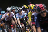 Denmark's Jonas Vingegaard, wearing the best young rider's white jersey, follows Slovenia's Tadej Pogacar, wearing the overall leader's yellow jersey, right, while Australia's Ben O'Connor, left, drinks, during the eighteenth stage of the Tour de France cycling race over 129.7 kilometers (80.6 miles) with start in Pau and finish in Luz Ardiden, France,Thursday, July 15, 2021. (AP Photo/Christophe Ena)