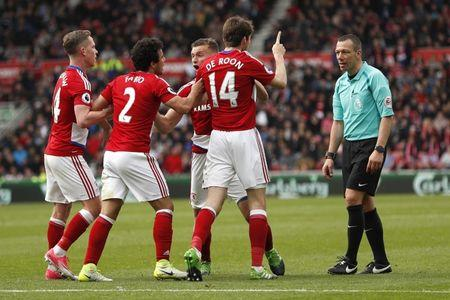 Middlesbrough's Marten De Roon remonstrates with Referee Kevin Friend after conceding a penalty
