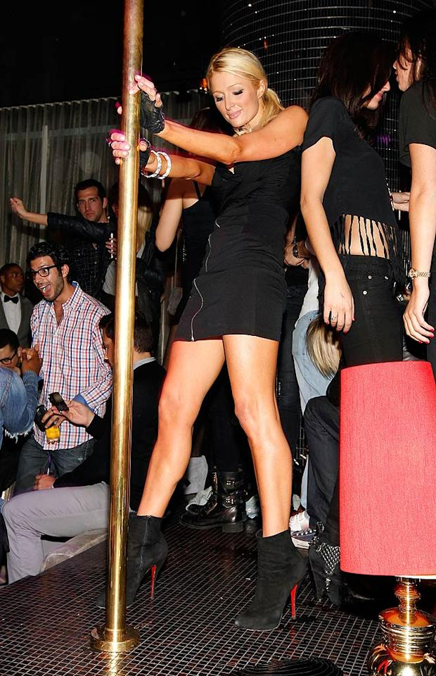 """Paris tried out her dance moves on the stripper pole. Do you think she was wearing those gloves for extra grip? Christopher Polk/<a href=""""http://www.wireimage.com"""" target=""""new"""">WireImage.com</a> - April 28, 2010"""
