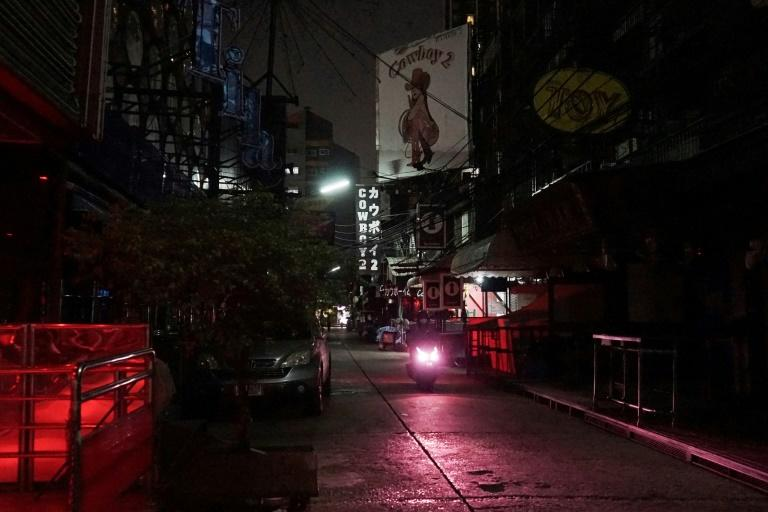 The occasional tourist loiters near clusters of sex workers, before a furtive negotiation and a quick march to a nearby hotel, one of the few still open on Bangkok's main tourist drag