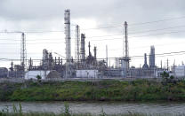 The Motiva refinery, the largest oil refinery in North America, is shown Monday, March 23, 2020, in Port Arthur, Texas. The Texas Gulf Coast is the United States' petrochemical corridor, with four of the country's 10 biggest oil and gas refineries and thousands of chemical facilities. (AP Photo/David J. Phillip)