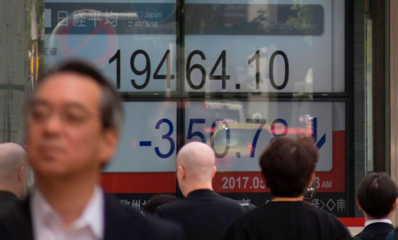 Asian equities trade cautiously following recovery on Wall Street overnight