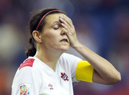 Canada's Christine Sinclair wipes her face as she leaves the pitch after a 1-1 draw with the Netherlands during Women's World Cup soccer Monday, June 15, 2015 in Montreal.THE CANADIAN PRESS/Ryan Remiorz