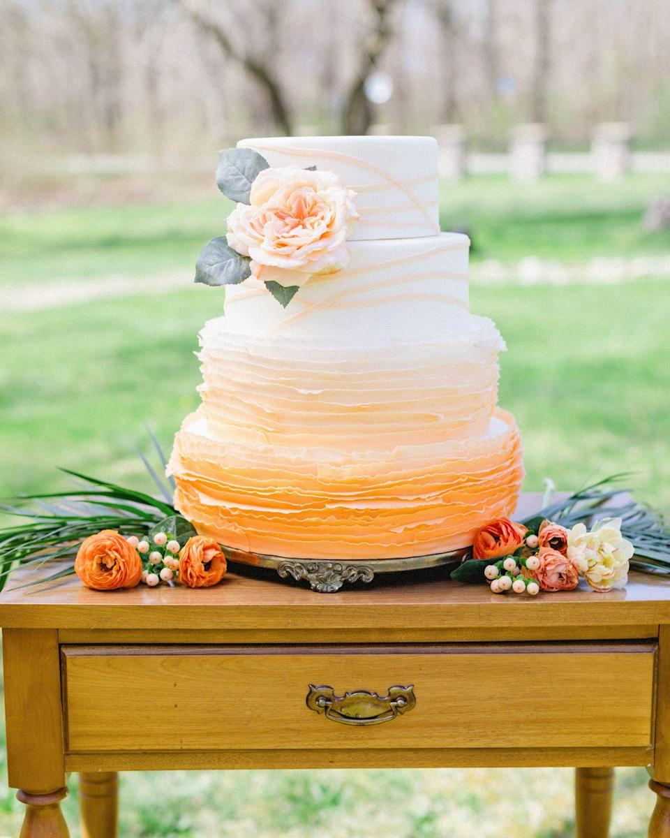 """<p>Autumnal orange fades into white on this ombre fall wedding cake from <a href=""""https://www.designedbydaddy.net/"""" rel=""""nofollow noopener"""" target=""""_blank"""" data-ylk=""""slk:Designed by Daddy"""" class=""""link rapid-noclick-resp"""">Designed by Daddy</a>.</p>"""