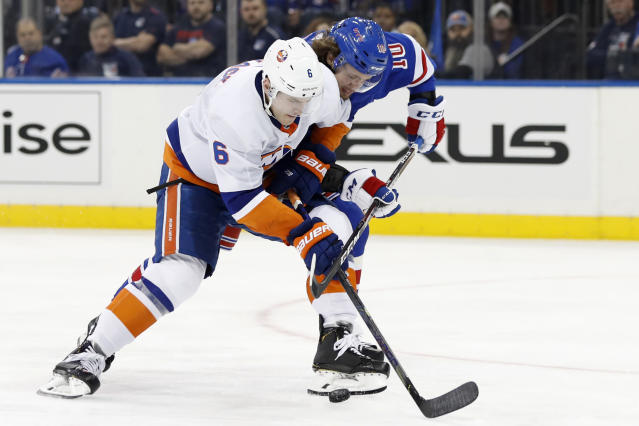 New York Islanders defenseman Ryan Pulock (6) tries to fend off New York Rangers left wing Artemi Panarin (10) during the second period of an NHL hockey game, Monday, Jan. 13, 2020, in New York. (AP Photo/Kathy Willens)