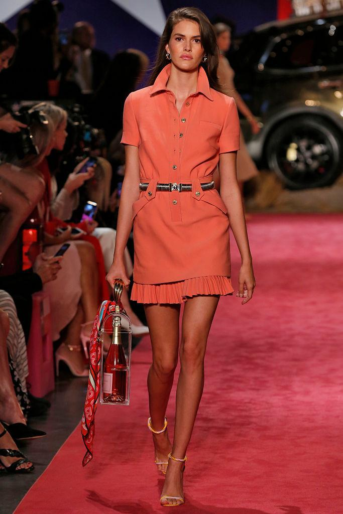 <p>A model walks the runway carrying a clear plastic rosé case at the Brandon Maxwell Spring/Summer 2019 show during New York Fashion Week on Sept. 8. (Photo: Victor Virgile/Gamma-Rapho via Getty Images) </p>