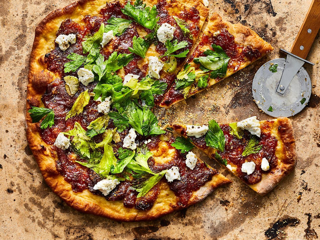 "<p>Using a pizza stone is the key to achieving a delectably crispy crust on this easy flatbread. While we baked ours in the oven, you could easily heat your pizza stone on the grill if you'd rather not heat up the kitchen. Featuring our easy<a href=""https://www.myrecipes.com/recipe/fresh-fig-jam""> fig jam</a>, along with tangy goat cheese and vibrant celery and herb salad, the pizzas can serve four as a light summer entree or more as an elegant appetizer. If you want to bulk the flatbreads up with a little extra protein, try adding sliced prosciutto or shredded rotisserie chicken. </p> <p><a href=""https://www.myrecipes.com/recipe/fig-jam-goat-cheese-flatbread"">Fig Jam and Goat Cheese Flatbread Recipe</a></p>"