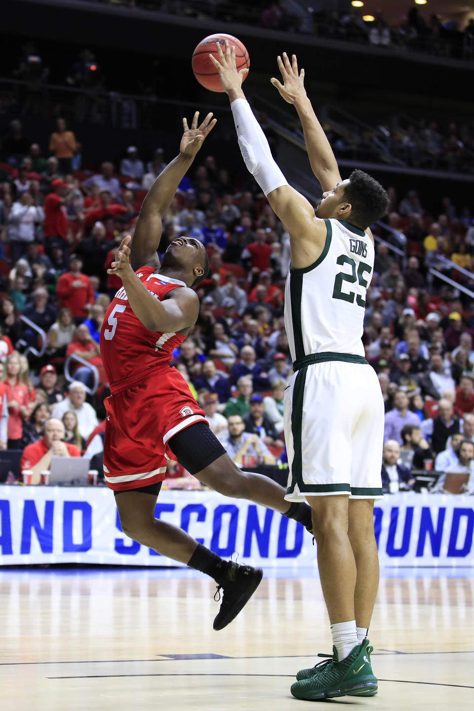 <p>Darrell Brown #5 of the Bradley Braves throws up a shot against Kenny Goins #25 of the Michigan State Spartans during their game in the First Round of the NCAA Basketball Tournament at Wells Fargo Arena on March 21, 2019 in Des Moines, Iowa. (Photo by Andy Lyons/Getty Images) </p>