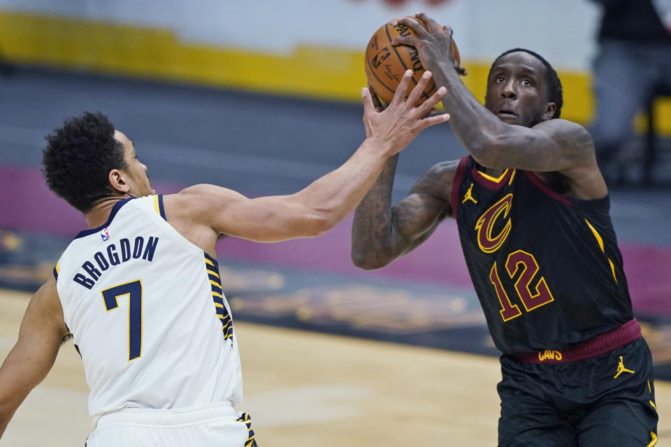 Cleveland Cavaliers' Taurean Prince (12) drives to the basket against Indiana Pacers' Malcolm Brogdon (7) during the first half of an NBA basketball game Wednesday, March 3, 2021, in Cleveland. (AP Photo/Tony Dejak)