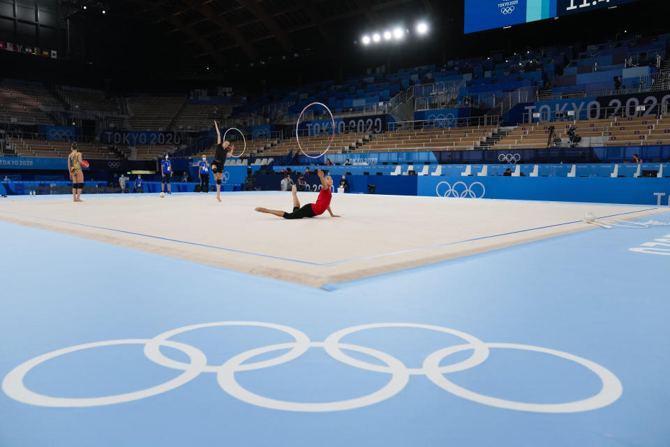 Evita Griskenas front in red, of the United States performs during a rhythmic gymnastics individual training session at the 2020 Summer Olympics, Thursday, Aug. 5, 2021, in Tokyo, Japan. (AP Photo/Markus Schreiber)