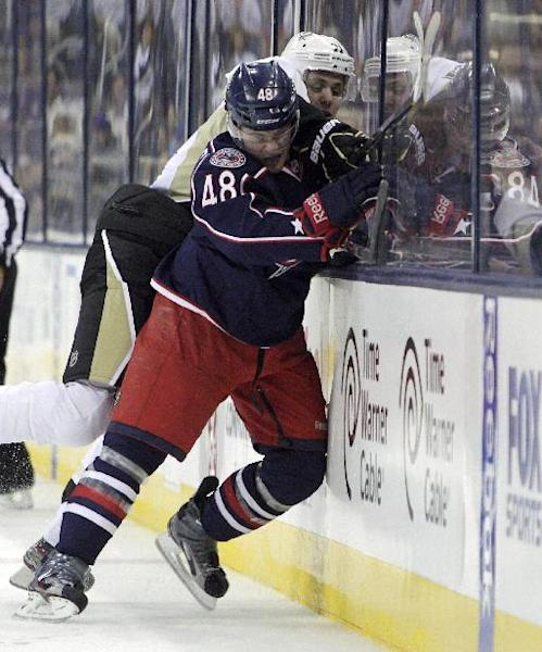 Blue Jackets' Cody Goloubef, front, checks Pittsburgh Penguins' Evgeni Malkin, of Russia, during the first period of an NHL preseason hockey game, Sunday, Sept. 15, 2013, in Columbus, Ohio. (AP Photo/Jay LaPrete)
