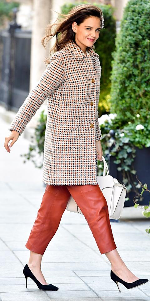 """<p>The actress took Manhattan in this Jackie Kennedy-esque houndstooth <a rel=""""nofollow"""" href=""""http://www.starstyle.com/shop/a-p-c-lilli-coat-sp278273/"""">A.P.C. coat</a>, burnt orange leather capris, and a classic pair of black pumps (shop a similar look <a rel=""""nofollow"""" href=""""https://click.linksynergy.com/fs-bin/click?id=93xLBvPhAeE&subid=0&offerid=279716.1&type=10&tmpid=5458&RD_PARM1=http%253A%252F%252Fwww.bergdorfgoodman.com%252FGianvito-Rossi-Gianvito-Silk-105mm-Pump-Black%252Fprod122410164%252Fp.prod%253Fecid%253DBGCS__Polyvore%2526utm_medium%253DCSE%2526utm_source%253DBGCS__Polyvore&u1=ISPlaidCelebsPumpsIJMarch"""">here</a>). </p>"""