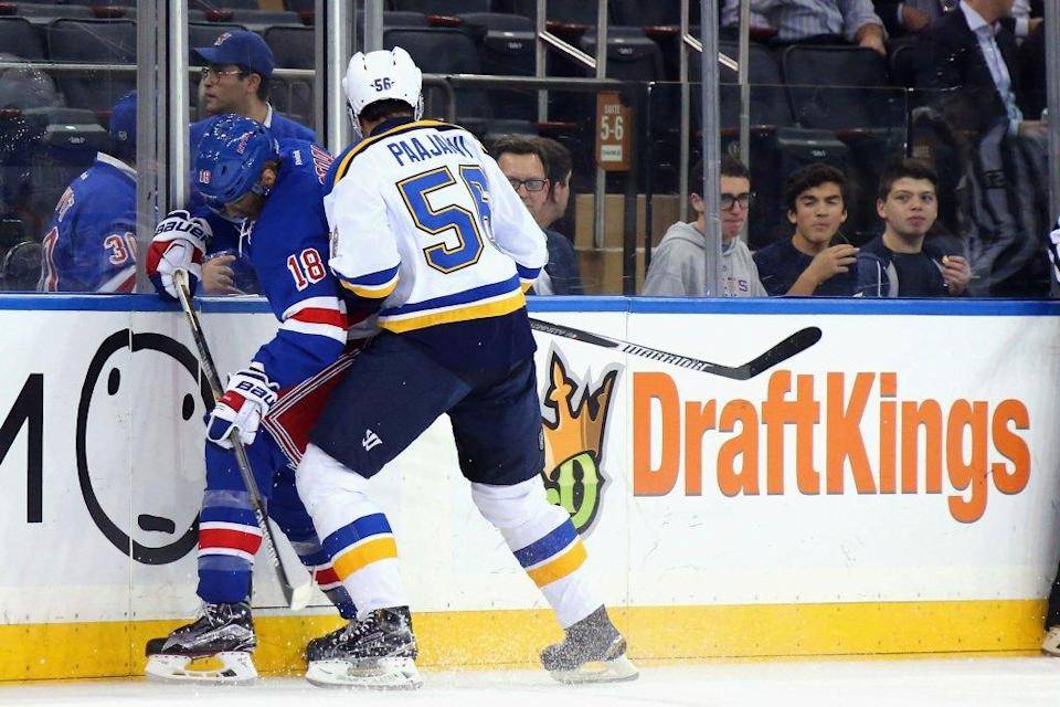 The New York Rangers and St. Louis Blues skate in front of a dasher board advertising the betting website DraftKings at Madison Square Garden on Nov. 12, 2015.