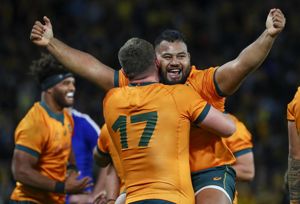 Australia's Taniela Tupou, right, and teammate Angus Bell celebrate after defeating France during the third rugby international between France and Australia at Suncorp Stadium in Brisbane, Australia, Saturday, July 17, 2021. (AP Photo/Tertius Pickard)