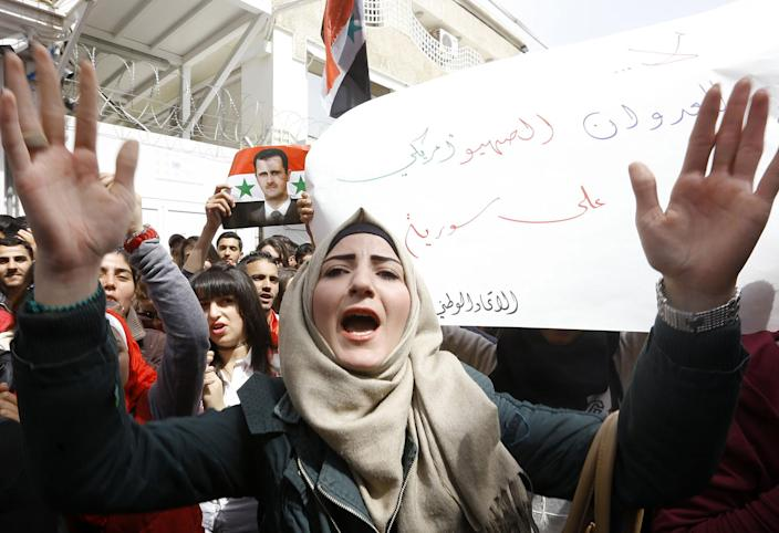 <p>A Syrian woman shouts slogans during a demonstration outside the United Nations office in Damascus, on April 11, 2017, in support of their country's President Bashar Assad. Hundreds of Syrian students gathered there to protest last week's American strike on a government air base. (Louai Beshara/AFP/Getty Images) </p>