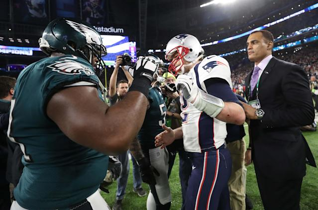 NFL Football - Philadelphia Eagles v New England Patriots - Super Bowl LII - U.S. Bank Stadium, Minneapolis, Minnesota, U.S. - February 4, 2018. Philadelphia Eagles' Fletcher Cox with New England Patriots' Tom Brady after the game. REUTERS/Chris Wattie
