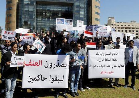 Lebanese and Arab students carry signs and Yemeni national flags during a protest against Saudi-led air strikes on Yemen, in front of the offices of the U.N. headquarters in Beirut April 1, 2015. REUTERS/Mohamed Azakir