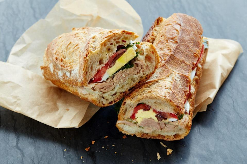 """When you think about it, """"pan pagnat"""" is just the French way of saying """"the best of all possible summer sandwiches."""" Unlike a plain-old tuna on wheat, this Provençal classic only gets better as it sits, making it just the thing for picnics, backyard suppers, and last-minute road trips. And its briny, garlicky flavors beat plain old mayo any day. <a href=""""https://www.epicurious.com/recipes/food/views/pan-bagnat-sandwich-with-tuna-anchovies-and-parsley-56389688?mbid=synd_yahoo_rss"""" rel=""""nofollow noopener"""" target=""""_blank"""" data-ylk=""""slk:See recipe."""" class=""""link rapid-noclick-resp"""">See recipe.</a>"""