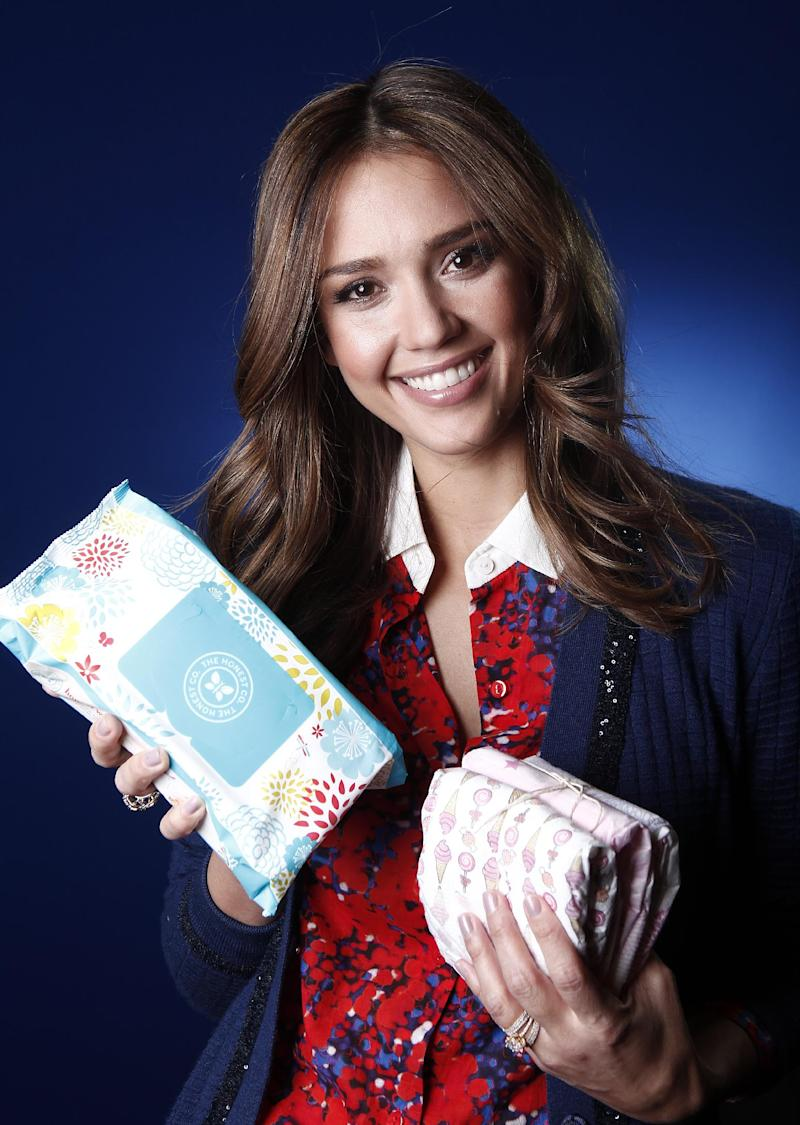 Actress Jessica Alba poses for a portrait Tuesday, Jan. 17, 2012, in New York to promote Honest.com, a new e-commerce eco friendly and non-toxic baby product company.  (AP Photo/Carlo Allegri)