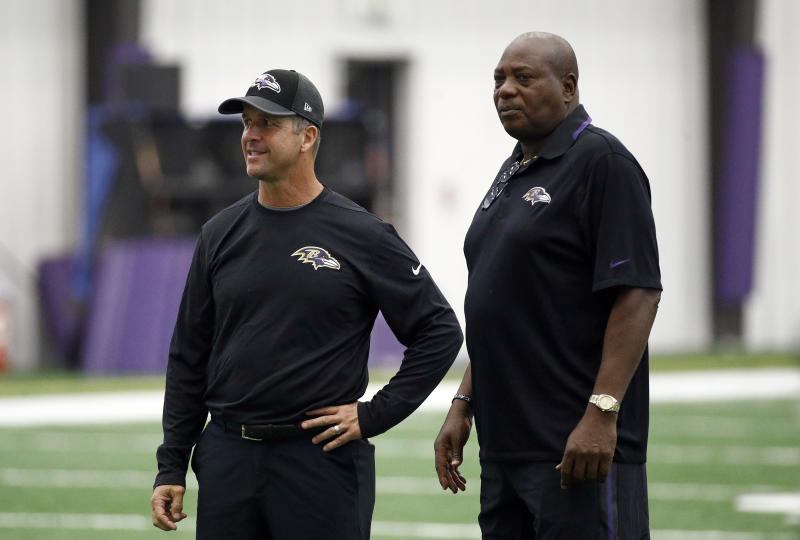 Baltimore Ravens head coach John Harbaugh, left, and general manager Ozzie Newsome at a practice last season. (AP)