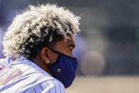 New York Mets shortstop Francisco Lindor stands in the dugout during the first inning of a baseball game against the Miami Marlins, Thursday, April 8, 2021, in New York. (AP Photo/John Minchillo)