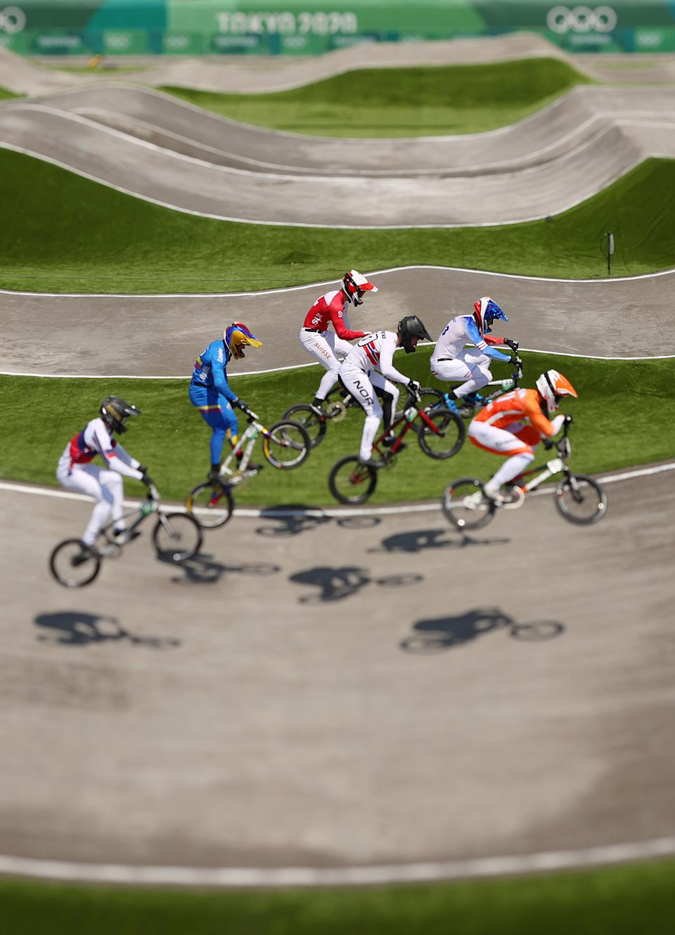 <p>A general view of Joris Harmsen of Team Netherlands, Tore Navrestad of Team Norway, Evgeny Kleshchenko of Team ROC, Vincent Pelluard of Team Colombia, Joris Daudet of Team France and Simon M. Marquart of Team Switzerland as they jump during the Men's BMX quarterfinal heat 3 run 1 on day six of the Tokyo 2020 Olympic Games at Ariake Urban Sports Park on July 29, 2021 in Tokyo, Japan. (Photo by Ezra Shaw/Getty Images)</p>